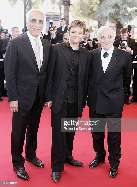 Actor/singer Gerard Darmon actor Damien Jouillerot and French singer Charles Aznavour attend the screening of Peindre Ou Faire L'Amour at the Palais...