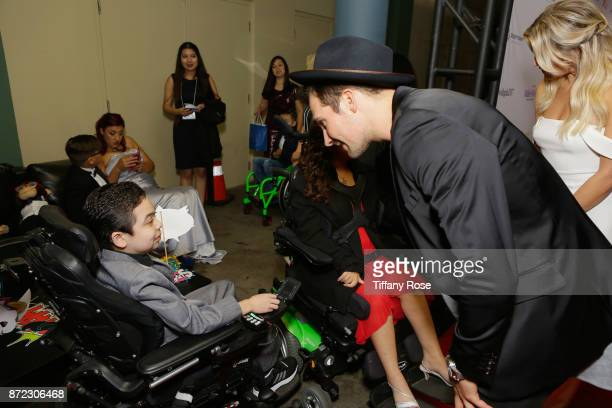 Actor/singer James Maslow and sportscaster Charissa Thompson with Wish Kids at the 2017 Make a Wish Gala on November 9 2017 in Los Angeles California