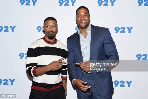 Actor/singer Jamie Foxx and former Professional Football Player/television personality Michael Strahan pose for a photo at 92nd Street Y Presents...