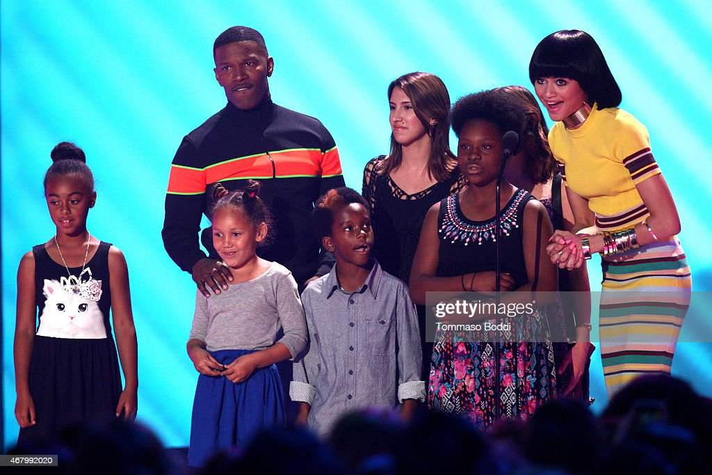 Actor/singer Jamie Foxx (L), guests and actress Zendaya (R) speak onstage during the Nickelodeon's 28th Annual Kids' Choice Awards held at The Forum on March 28, 2015 in Inglewood, California.