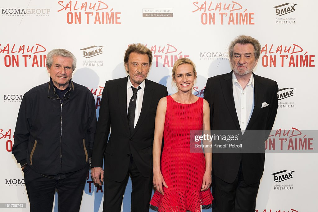 Actor/singer Johnny Hallyday, director Claude Lelouch, actress Sandrine Bonnaire and actor/singer Eddy Mitchell pose during the premiere of 'Salaud, on t'aime' (Bastard, we love you) directed by Lelouch at Cinema UGC Normandie on March 31, 2014 in Paris, France.