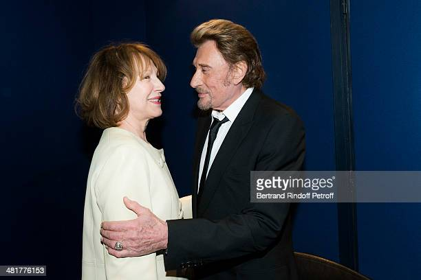 Actor/singer Johnny Hallyday hugs his former partner actress Nathalie Baye during the premiere of French director Claude Lelouch's film 'Salaud on...