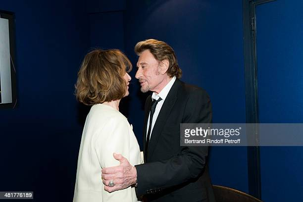 Actor/singer Johnny Hallyday shares a light moment with his former partner actress Nathalie Baye during the premiere of French director Claude...