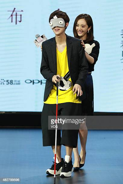 Actor/singer Lu Han and actress Yang Mi attend film 'The Witness' press conference on August 2 2015 in Beijing China