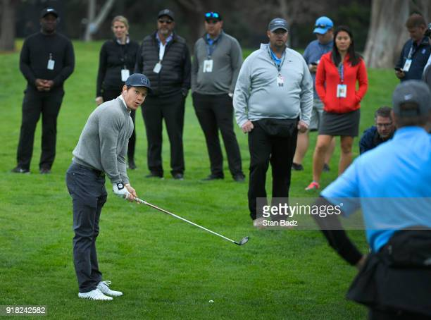 Actor/singer Mark Wahlberg warns fans before hitting his second shot on the second hole during the ProAm round for the Genesis Open at Riviera...