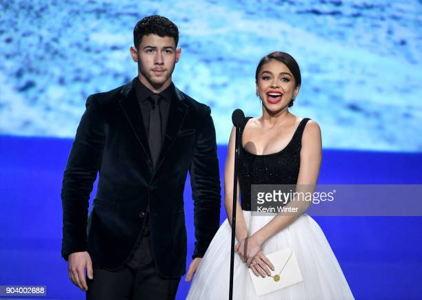 Actor/singer Nick Jonas and actor Sarah Hyland speak onstage during The 23rd Annual Critics' Choice Awards at Barker Hangar on January 11 2018 in...
