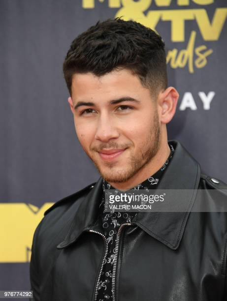 US actor/singer Nick Jonas attends the 2018 MTV Movie TV awards at the Barker Hangar in Santa Monica on June 16 2018 This year's show is not live It...