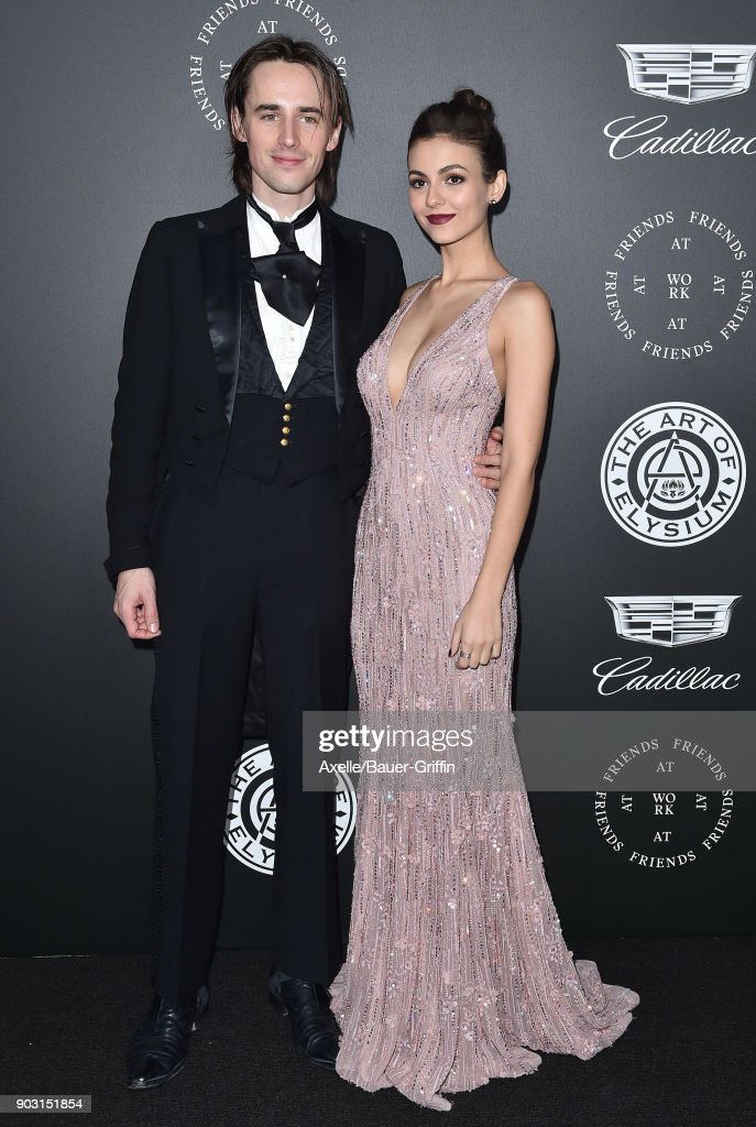 Actor/singer Reeve Carney and actress Victoria Justice arrive at The Art of Elysium's 11th Annual Celebration - Heaven at Barker Hangar on January 6, 2018 in Santa Monica, California.