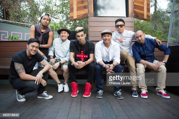 Actor/singer Roshon Fegan poses with The Jabbawockeez backstage at the Rebuild benefit concert for Typhoon Haiyan survivors at The Greek Theatre on...