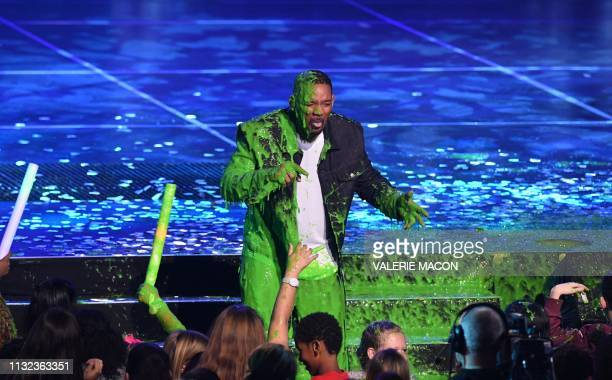 TOPSHOT Actor/singer Will Smith gets slimed on stage during the 32nd Annual Nickelodeon Kids' Choice Awards at the USC Galen Center on March 23 2019...