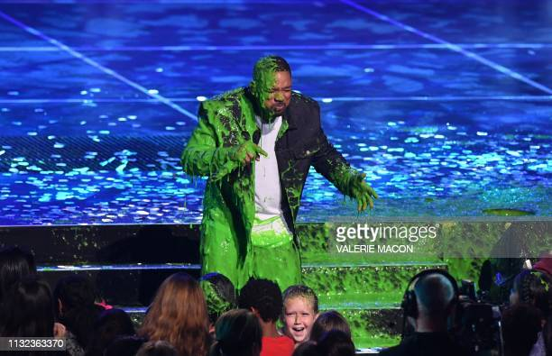 Actor/singer Will Smith gets slimed on stage during the 32nd Annual Nickelodeon Kids' Choice Awards at the USC Galen Center on March 23 2019 in Los...