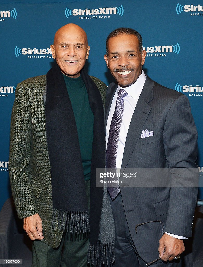 Actor/singer/activist Harry Belafonte (L) and SiriusXM host Joe Madison attend SiriusXM's Town Hall at SiriusXM studios on January 25, 2013 in New York City.
