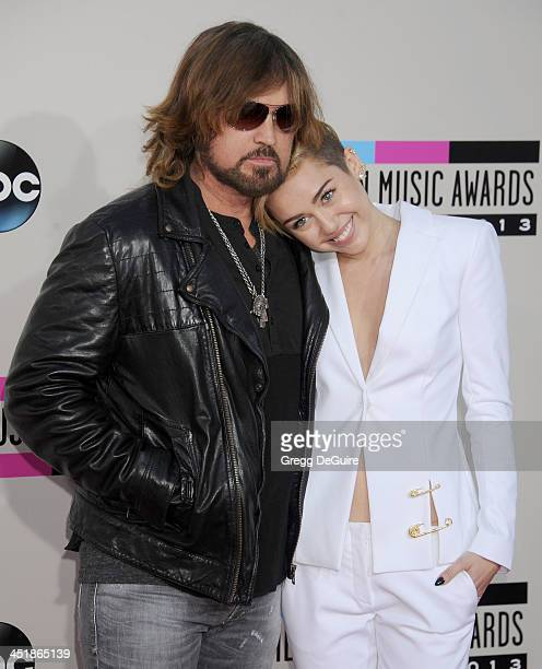 Actor/singers Billy Ray Cyrus and Miley Cyrus arrive at the 2013 American Music Awards at Nokia Theatre LA Live on November 24 2013 in Los Angeles...