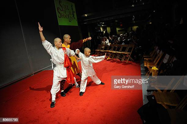Actors/martial artists Yu Fei Zhang Zhigang and Wang Sen perform during a press preview of Soul of Shaolin on Broadway at the New World Stages on...