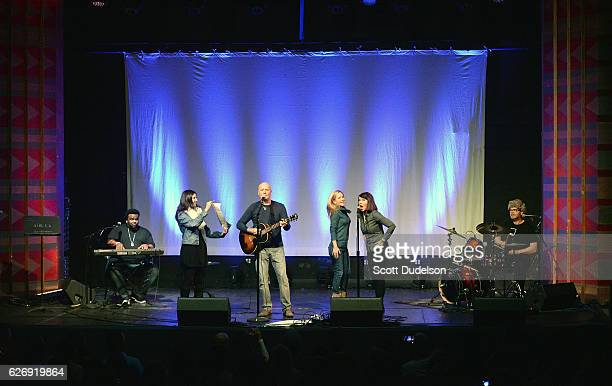 Actors/musicians Craig Robinson Creed Bratton Angela Kinsey Kate Flannery and Rainn Wilson from the TV show The Office perform onstage during Creed...