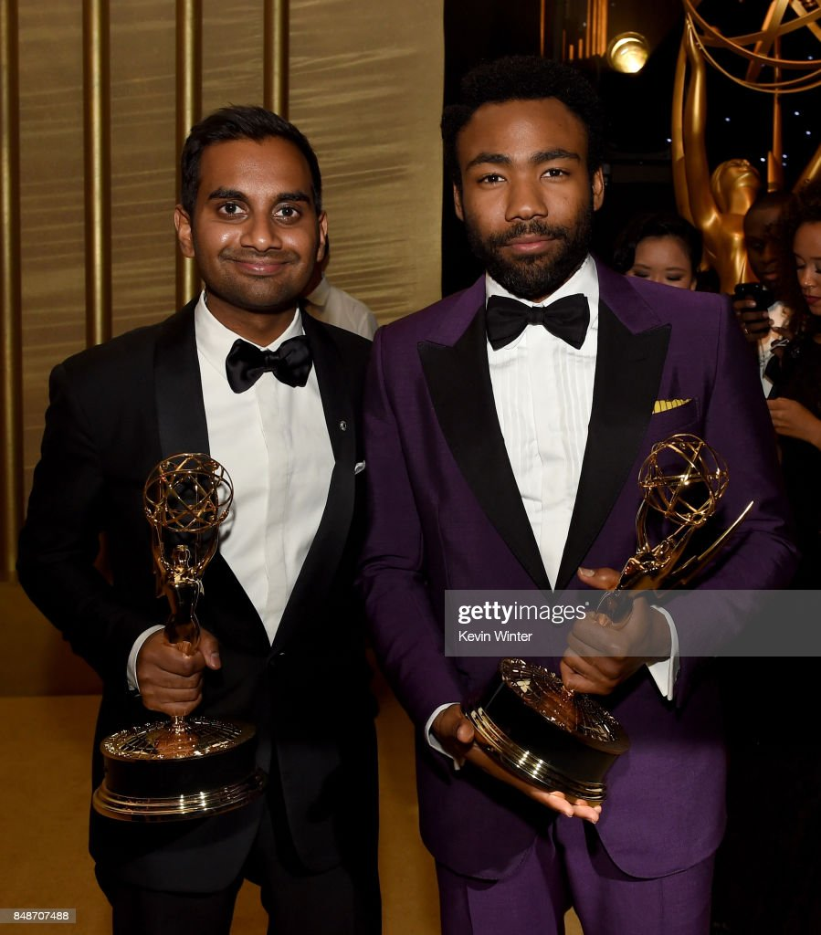 Actors/writers Aziz Ansari (L), winner of Outstanding Writing for a Comedy Series for 'Master of None,' and Donald Glover, winner of Outstanding Lead Actor in a Comedy Series for 'Atlanta,' attend the 69th Annual Primetime Emmy Awards Governors Ball on September 17, 2017 in Los Angeles, California.