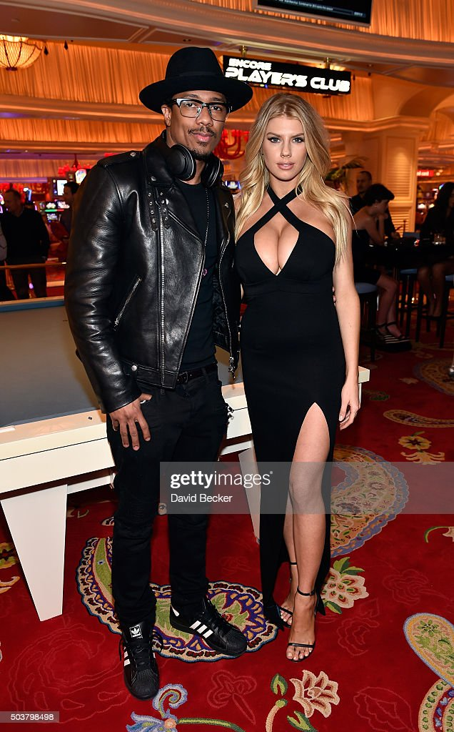Actor/television personality Nick Cannon (L) and model Charlotte McKinney attend the Encore Player's Club grand opening celebration at Wynn Las Vegas on January 6, 2016 in Las Vegas, Nevada.