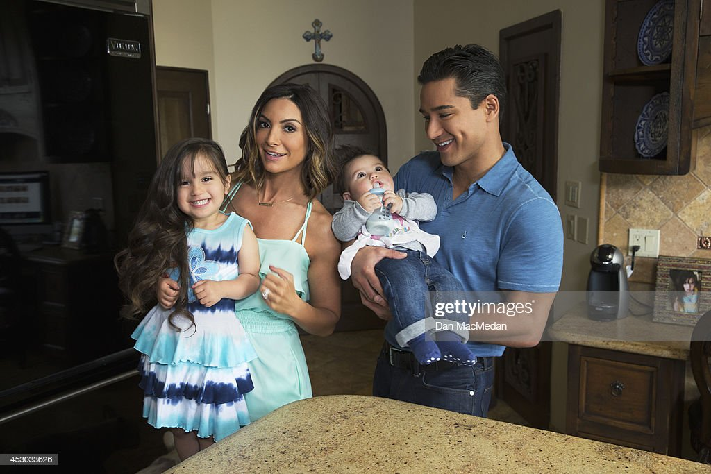 Actor/TV host, Mario Lopez and his family, wife Courtney, daughter Gia and son Dominic, are photographed in their home for USA Today's Back To School Magazine on July 15, 2014 in Glendale, California.