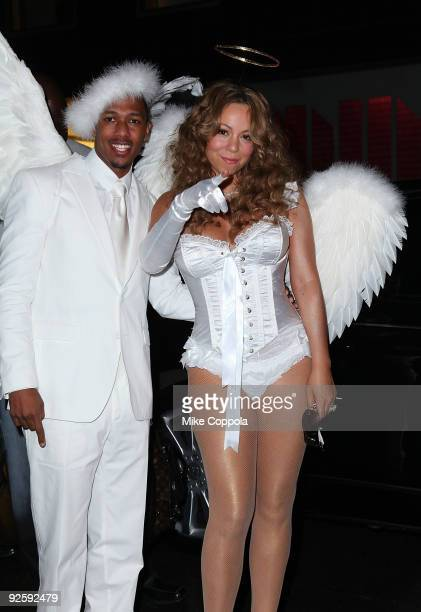 Actor-TV personality Nick Cannon and singer Mariah Carey attends a Halloween celebration at M2 Ultra Lounge on October 31, 2009 in New York City.