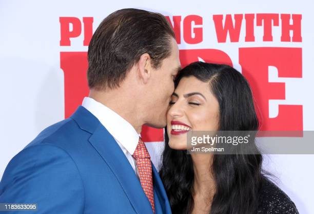 Actor/wrestler John Cena and Shay Shariatzadeh attend the Playing With Fire New York premiere at AMC Lincoln Square Theater on October 26 2019 in New...