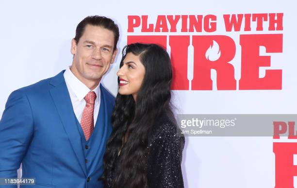 "Actor/wrestler John Cena and Shay Shariatzadeh attend the ""Playing With Fire"" New York premiere at AMC Lincoln Square Theater on October 26, 2019 in..."