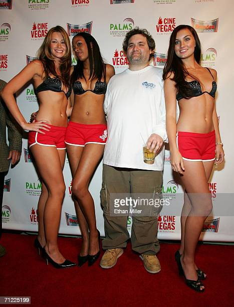 Actor/writer Artie Lange poses with models Kate Holster Trisha Thompson and Andrea Tiede wearing the Starcup bra as he arrives at the premiere 'Artie...