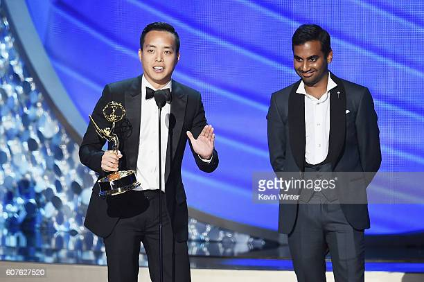 Actor/writer Aziz Ansari and writer Alan Yang accept Outstanding Writing for a Comedy Series for the 'Master of None' episode 'Parents' onstage...