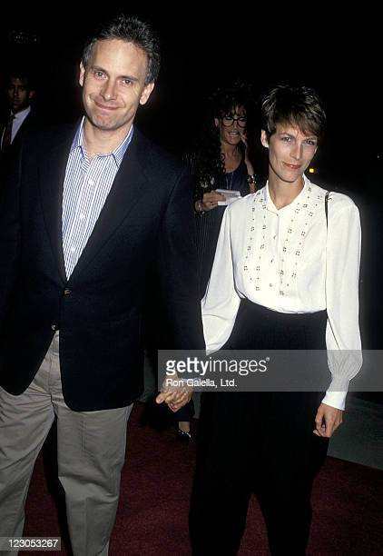 Actor/Writer Christopher Guest and actress Jamie Lee Curtis attend the Baby Boom Beverly Hills Premiere on October 6 1987 at the Academy Theatre in...