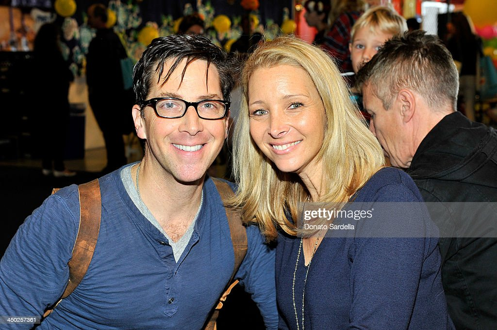 Actor/writer Dan Bucatinsky (L) and actress Lisa Kudrow attend the P.S. Arts Express Yourself 2013 event held at Barker Hangar on November 17, 2013 in Santa Monica, California.