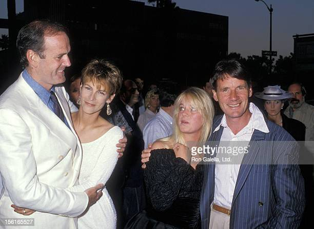 Actor/Writer John Cleese actress Jamie Lee Curtis writer Michael Palin and wife Helen Gibbins attend 'A Fish Called Wanda' Beverly Hills Premiere on...