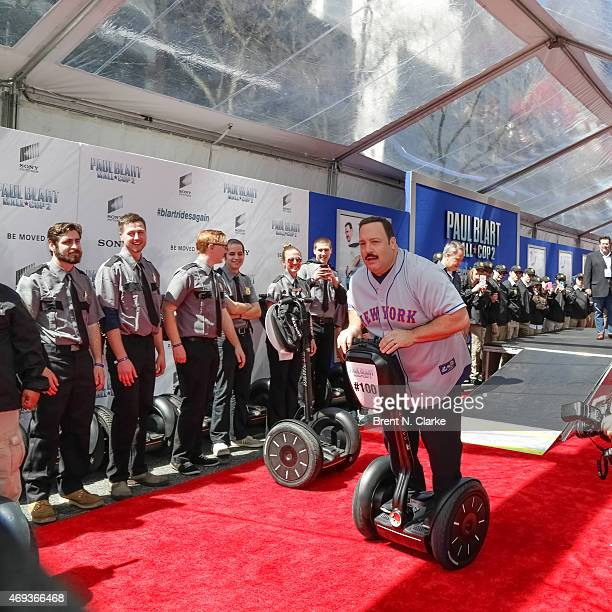 """Actor/writer/producer Kevin James, pictured on a segway scooter, arrives for the """"Paul Blart: Mall Cop 2"""" New York Premiere at AMC Loews Lincoln..."""