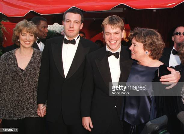 Actorwriters Ben Affleck and Matt Damon arrive with their mothers Chris and Nancy at the 70th Annual Academy Awards 23 March in Los Angeles CA...