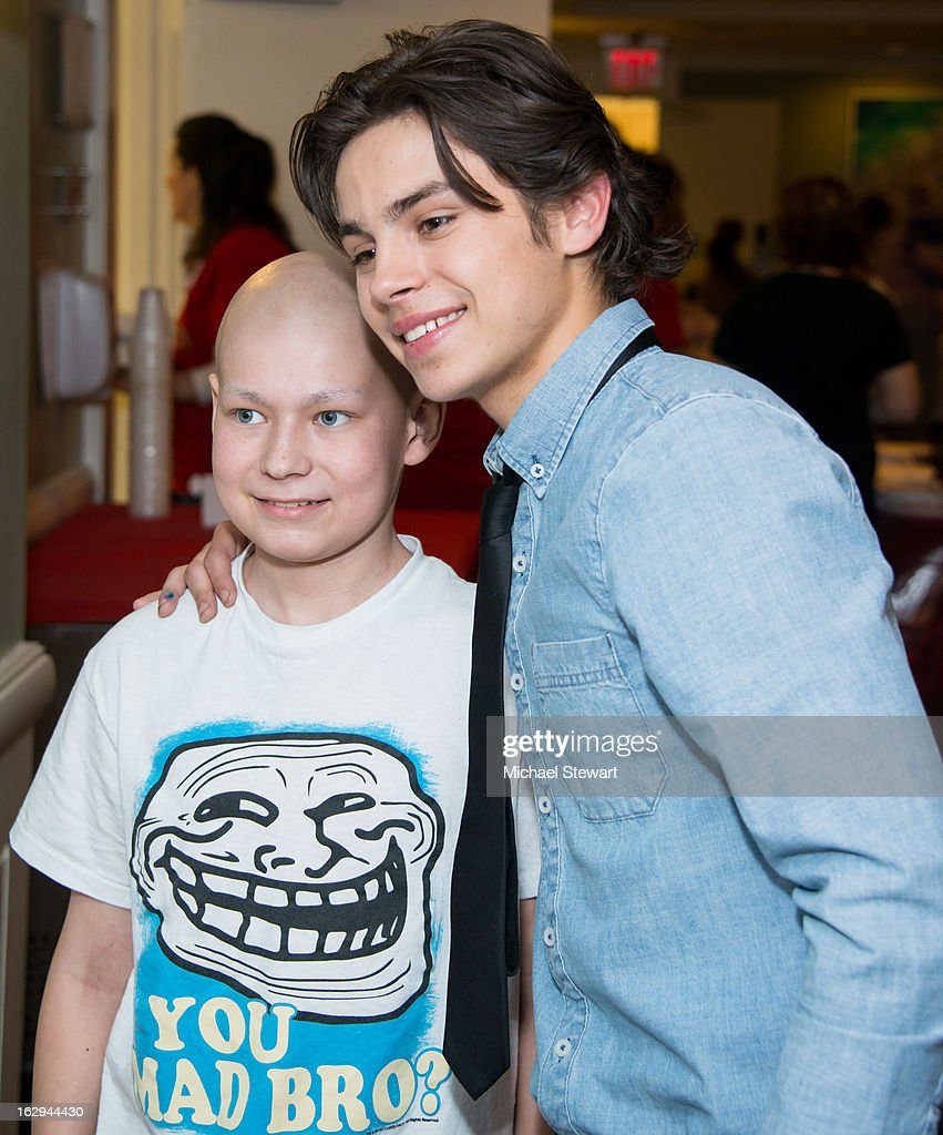 Actor/Youth Ambassador Jake T. Austin (R) visits the Ronald McDonald House on March 1, 2013 in New York City.