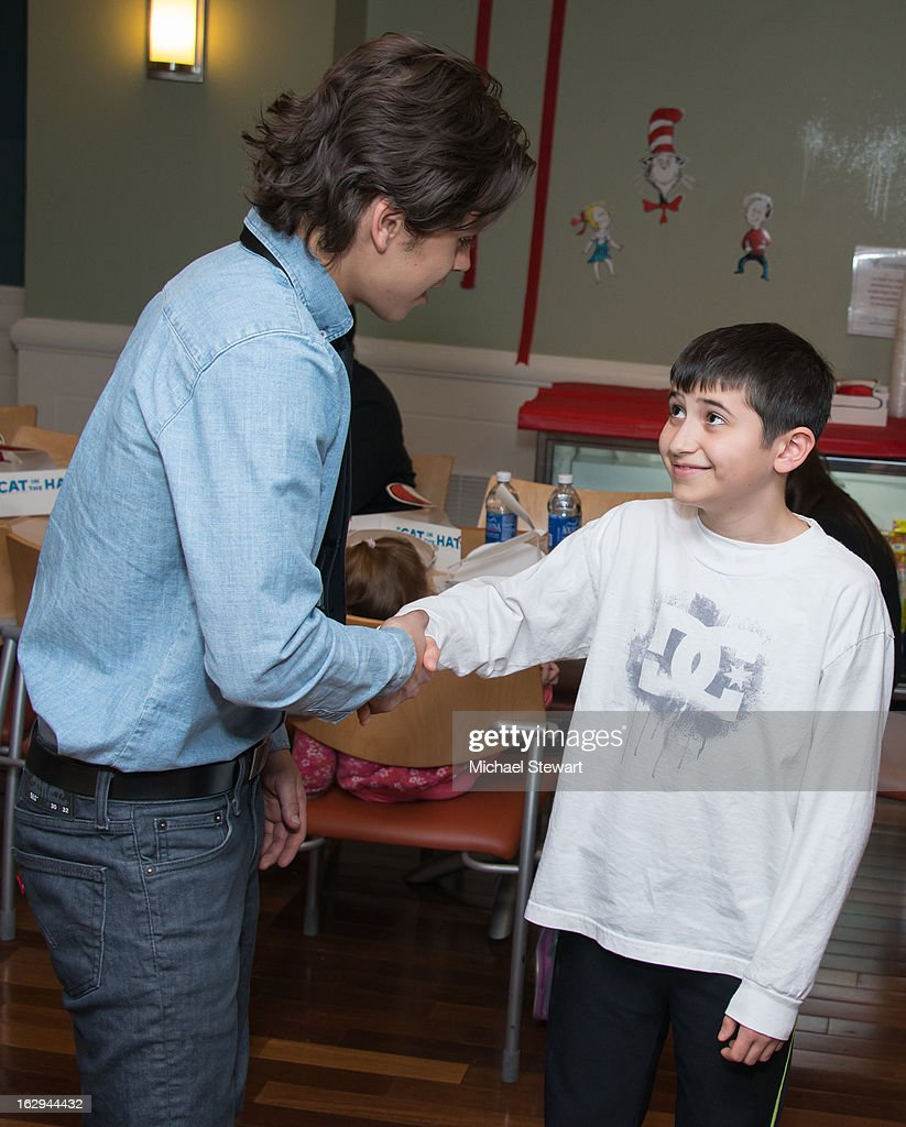 Actor/Youth Ambassador Jake T. Austin (L) visits the Ronald McDonald House on March 1, 2013 in New York City.