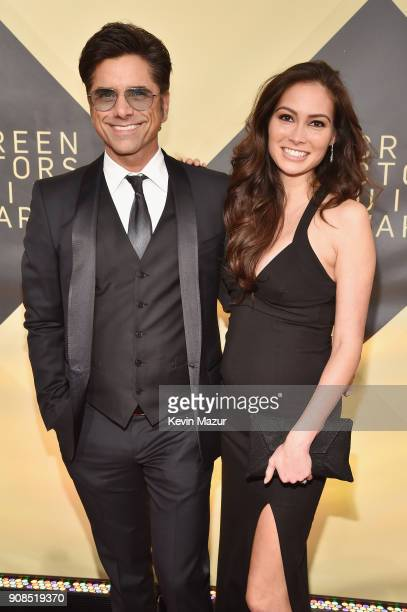 Actos John Stamos and Caitlin McHugh attend the 24th Annual Screen Actors Guild Awards at The Shrine Auditorium on January 21 2018 in Los Angeles...