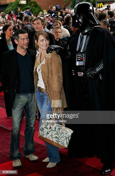 Actredd Anja Kling and her husband Jens Solf and Darth Vader pose at a cinema for the German premiere of Star Wars Episode III Revenge of the Sith on...