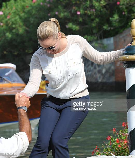 Actress Abbie Cornish boards a motorboat at Venice Lido during the 68th Venice Film Festival on September 3, 2011. AFP PHOTO / ALBERTO PIZZOLI