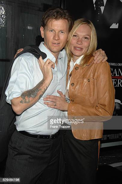 Actress Abby Brammell and husband arrive at the premiere of 'American Gangster' held at the ArcLight Cinemas in Hollywood
