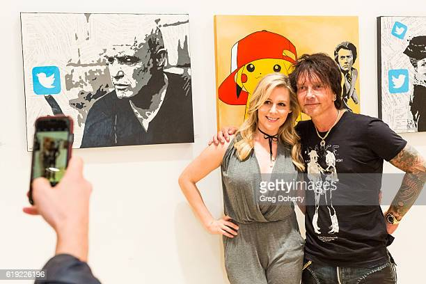 Actress Abi Titmuss and Artist Billy Morrison pose for a picture at the Gallery Opening Of 'Social Distortion A Capsule Collection Of Fine Art By...