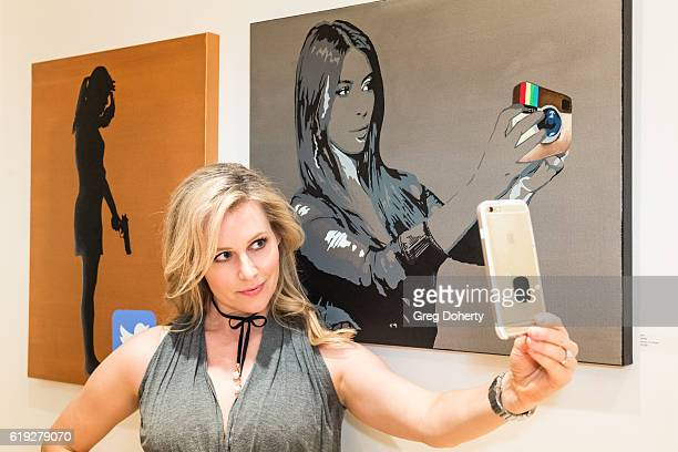 Actress Abi Titmuss takes a selfie at the Gallery Opening Of 'Social Distortion A Capsule Collection Of Fine Art By Billy Morrison' at Art On Scene...
