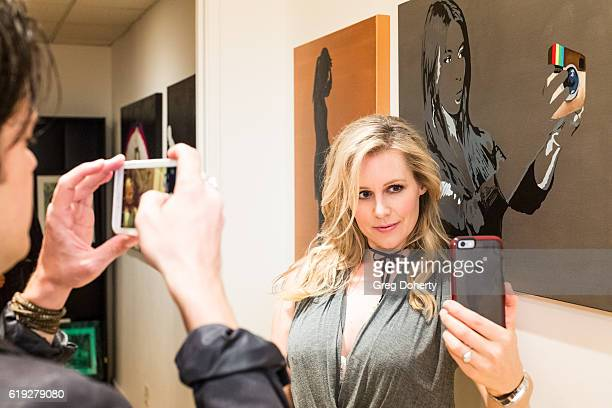 Actress Abi Titmuss takes a selfie at the Gallery Opening Of Social Distortion A Capsule Collection Of Fine Art By Billy Morrison at Art On Scene on...