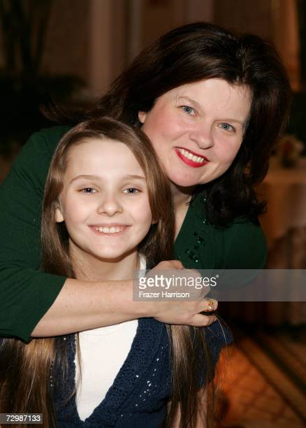 Actress Abigail Breslin and mother Kim Breslin pose inside at the 7th Annual AFI Awards luncheon held at the Four Seasons Hotel on January 12 2007 in...