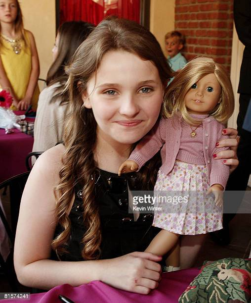 Actress Abigail Breslin poses with the Kit Kittredge doll at the after party for the premiere of Picturehouse's Kit Kittredge An American Girl at...