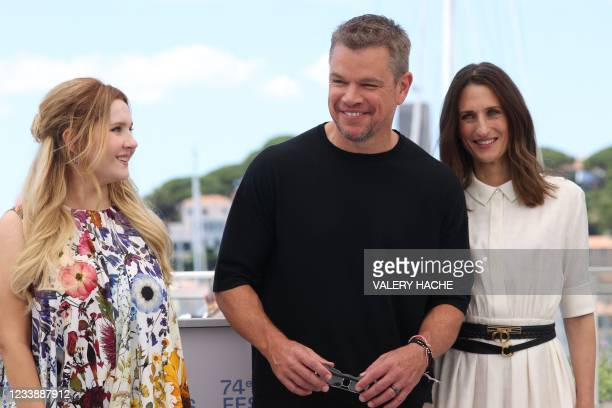 """Actress Abigail Breslin, US actor Matt Damon and French actress Camille Cottin pose during a photocall for the film """"Stillwater"""" at the 74th edition..."""