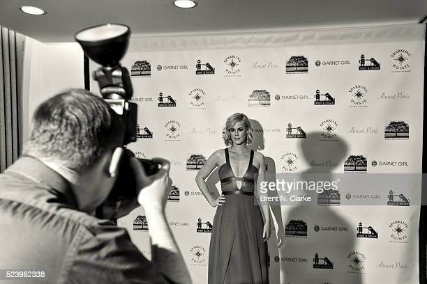 Actress Abigail Hawk poses for photographs during the 'Almost Paris' premiere after party on April 24 2016 in New York City