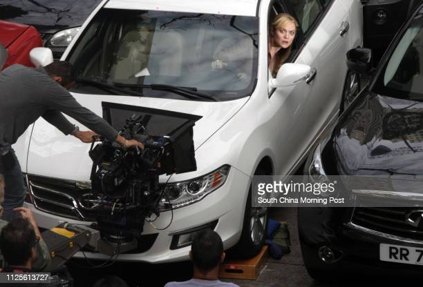 Actress Abigail Klein and crew members of Transformers 4 shoot a scene of the movie in Quarry Bay 18OCT13