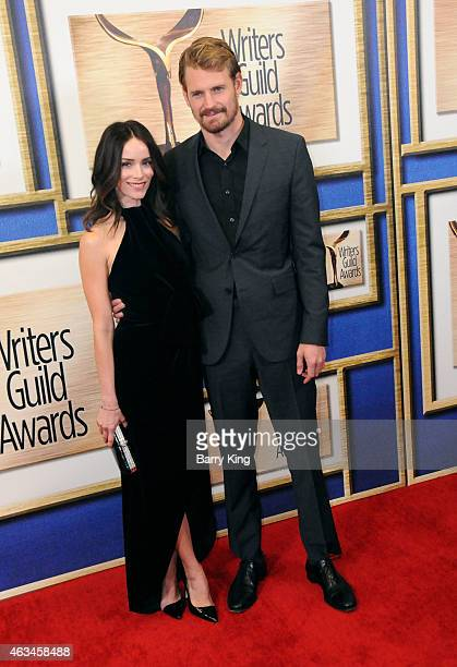 Actress Abigail Spencer and actor Josh Pence arrive at the 2015 Writers Guild Awards at the Hyatt Regency Century Plaza on February 14 2015 in Los...