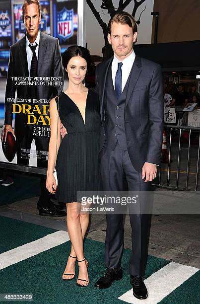 Actress Abigail Spencer and actor Josh Pence attend the premiere of Draft Day at Regency Bruin Theatre on April 7 2014 in Los Angeles California