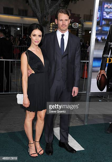 Actress Abigail Spencer and Andrew Pruett attend the Los Angeles premiere of 'Draft Day' at Regency Village Theatre on April 7 2014 in Westwood...