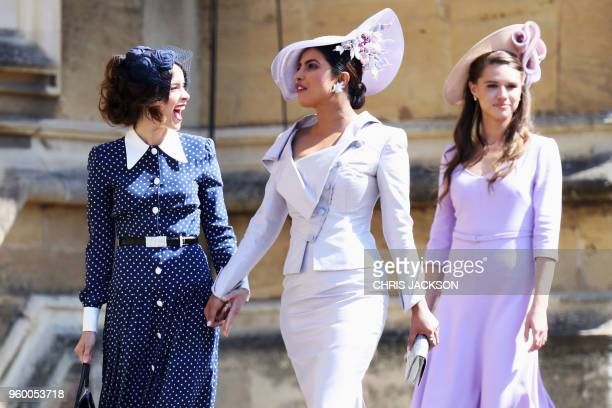 US actress Abigail Spencer and Bollywood actress Priyanka Chopra arrive for the wedding ceremony of Britain's Prince Harry Duke of Sussex and US...